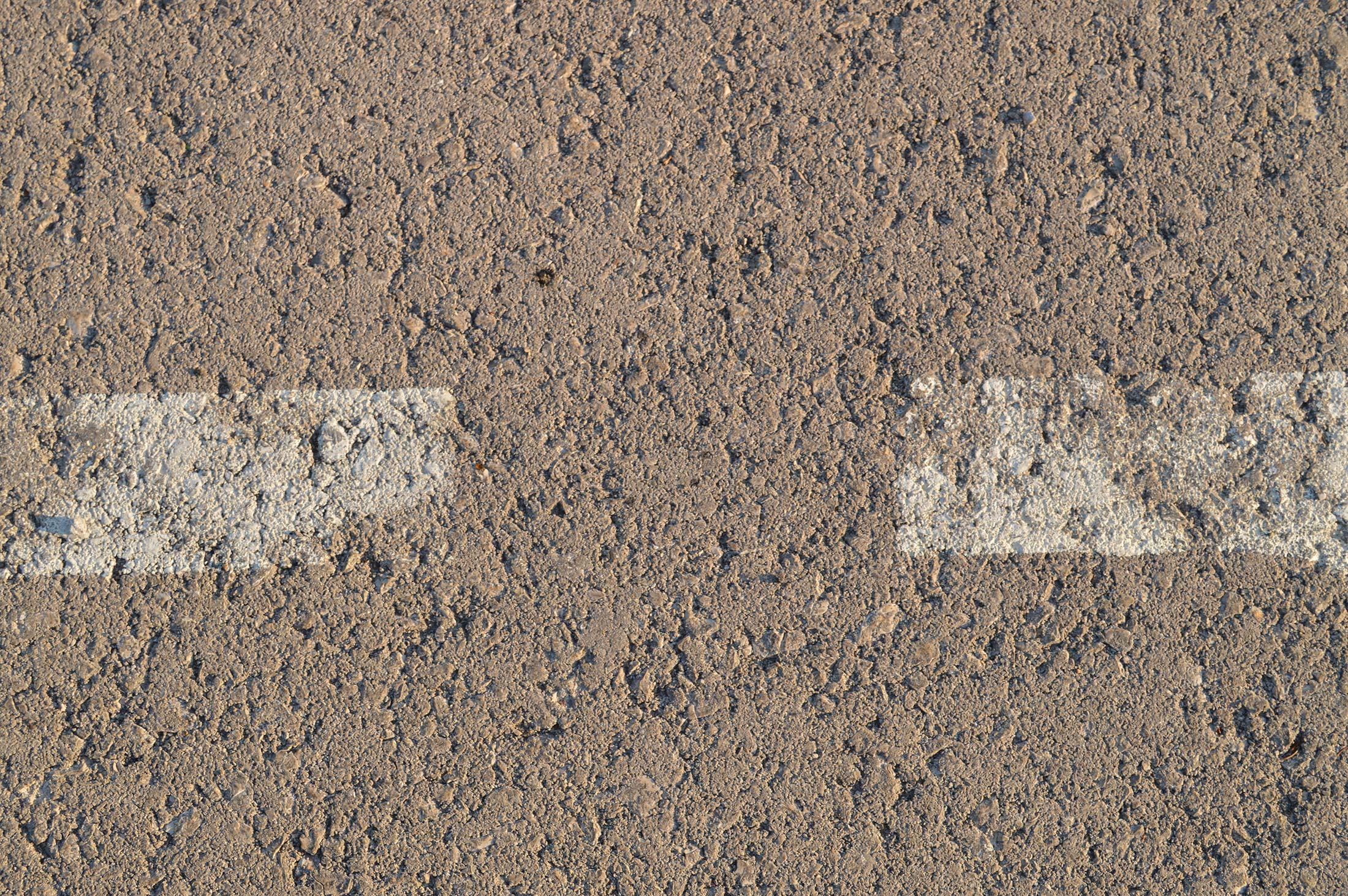 Asphalt with two white lines by Mish-A-Man